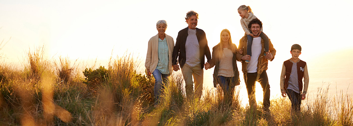 Family outdoors with grandparents enjoying day without worry of final planning